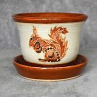 19-250 Hand thrown red squirrel themed plant pot with integral saucer