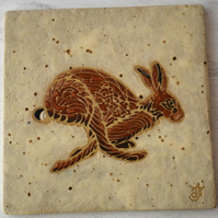 WP46R Wall plaque tile with running hare picture