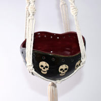 A30 Hand thrown skulls hanging planter