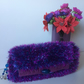 Striking sparkly clutch bag