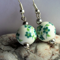 Ceramic floral bead with silver plate beads and findings