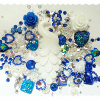 Rich royal blue and white peacock themed decoden kit. sparkle, gems, cabs.
