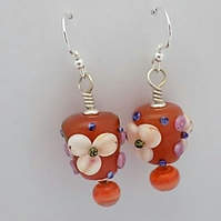 Sterling silver and carnelian cone lampwork floral earrings