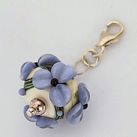 Periwinkle floral charm on sterling silver trigger clasp