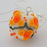 Sterling silver and lampwork glass orb pendant in daffodil design