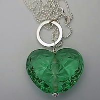Emerald green faceted heart lampwork pendant on 24 inch sterling silver chain