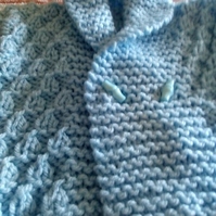 Hand knitted blue babies jacket