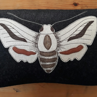 Hawkmoth free motion stitched and appliquéd cushion in wool, linen and leather