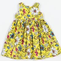 Mustard floral tea party dress. Snap fastener back and gathered waist detail.