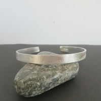 Sterling silver cuff bracelet with a frosted finish