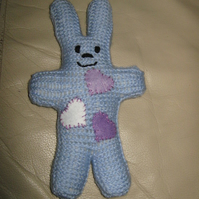 Hand knitted, pale blue heart cuddly rabbit