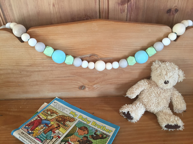 Wooden bead garland with blue and green painted beads. Wooden bead bunting