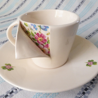 Under the surface sculptural porcelain teacup and saucer
