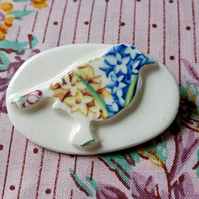 Porcelain bird brooch
