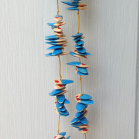 """Blue with red dot""  natural seed necklace; boho style"