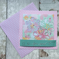 Pastel pink and green spotted floral card.