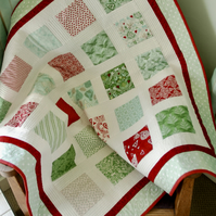 Red and green modern baby quilt