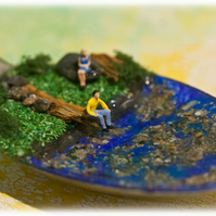 Miniature landscape in a spoon Altered spoon Swimming hole with NN people