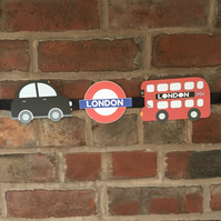 London Themed Nursery Garland Decoraton features soldiers black cab london bus