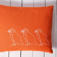 SALE Hand printed orange cushion - Puffins on Parade design