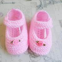 Hand knitted pink baby booties, pram shoes