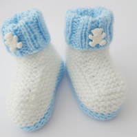 Knitted baby booties white and blue teddy bears