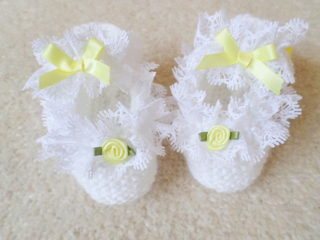 Hand knitted white baby girl shoes lace and bows