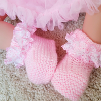 Knitted pink booties