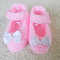 Pink knitted baby booties, Mary Jane shoes