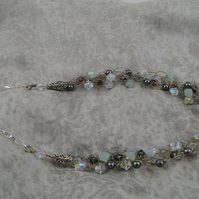 Sparkling soft blue and grey Swarovski Crystal crocheted necklace.