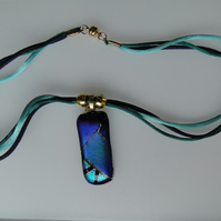 Blue and turquoise patchwork glass pendant.