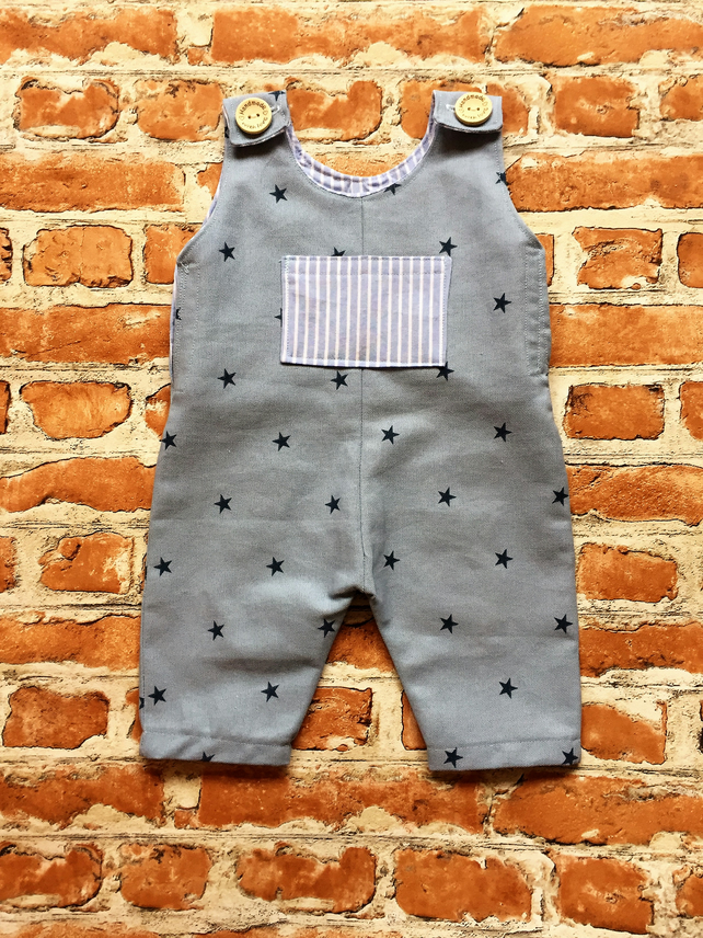 boys blue star romper with striped pocket detail