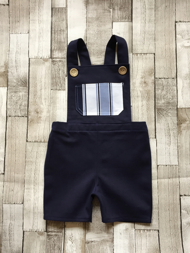 Boys navy blue dungarees with multi blue pocket detail