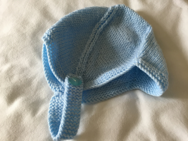 Hand knitted baby bonnets