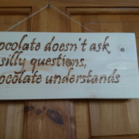 Pyrography wall or door plaque 'Chocolate doesn't ask silly questions...'