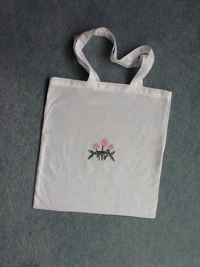 White cotton tote bag with hand embroidered clover motif
