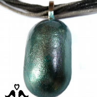 Petrol green small oval pendant on black and grey cord necklace.