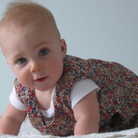 Pretty liberty lawn pinafore dress to suit a 6 month old baby.