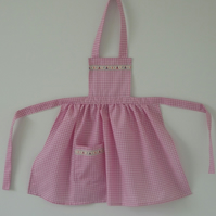 Pretty gingham apron with boat trim to suit a 2 to 3 year old