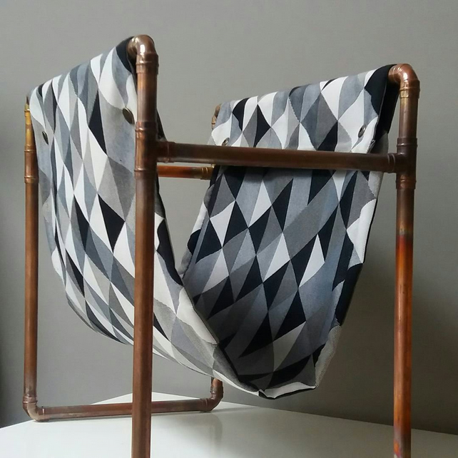 Copper pipe geometric fabric magazine rack
