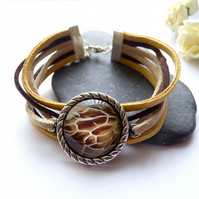 Brown suede bracelet. Bracelet with glass cabochon - giraffe pattern.