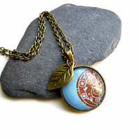 Gold necklace with leaf, with artwork, cabochon, glass, ethnic, flowers pattern