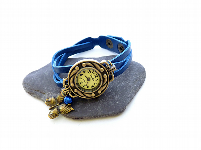 Navy watch with pendants; Butterfly and glass bead