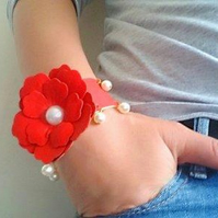 Leather bracelet with red flower