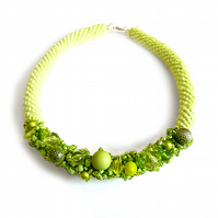 Green crochet necklace with glass beads