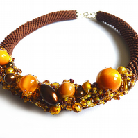 Brown crochet necklace with yellow beads