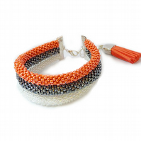 Triple beaded bracelet - crochet, orange, graphite, white