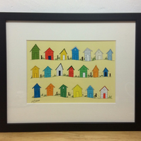 Beach huts by the sea - framed print