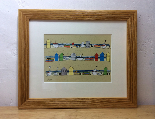 Beach huts and boats - framed print