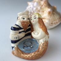 "Artistic ceramic -Sailor and mermaid- with the words ""Oceans of Love"" in a band."